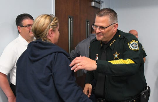 "Following a vote of approval for a finding of ""critical need"" related to his budget request, some residents shook hands with or hugged Brevard County Sheriff Wayne Ivey."