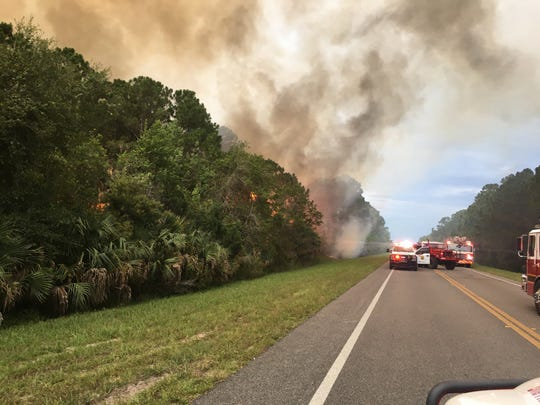 Brevard County Fire Rescue crews battle a five-acre brush fire near Titusville