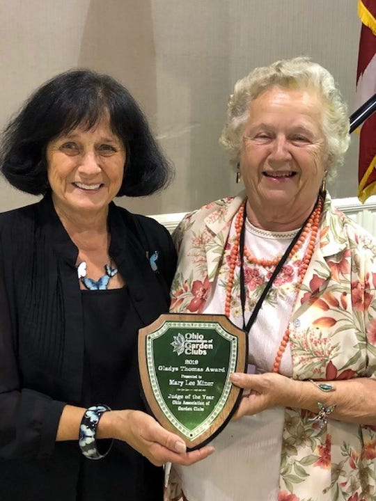 Mary Lee Minor (left) received the Gladys Thomas Judge of the Year award from Juanita Wilkins during the 89th Convention of The Ohio Association of Garden Clubs, which took place July 18-20 at the Roberts Center in Wilmington​​​​​​​.