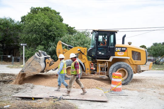 Construction crews work on Carroll Lane from Houston Street to McArdle Road on Tuesday, July 23, 2019. The projected is anticipated to be complete in July 2020.