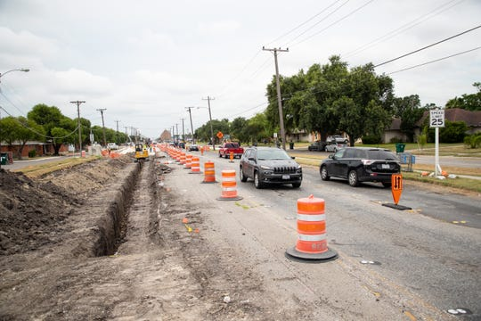Construction crews work on Staples Street from Brawner Parkway to Kostoryz Road on Tuesday, July 23, 2019.
