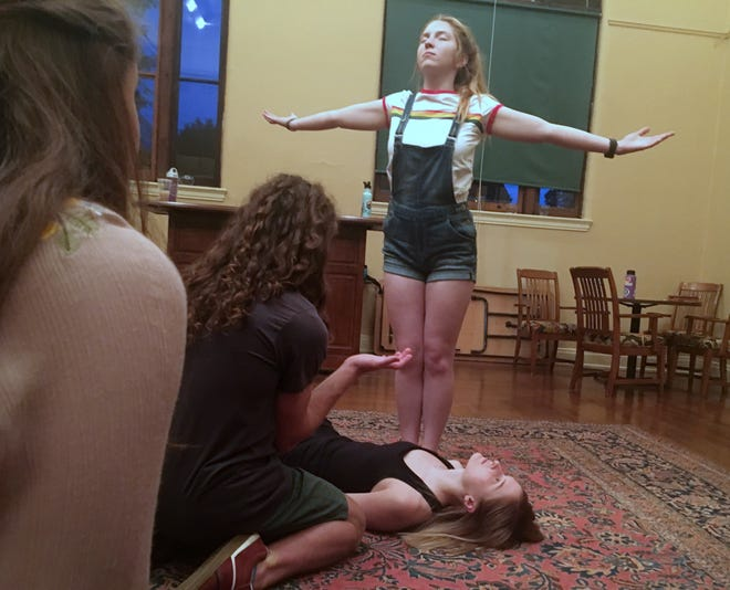 """Caitlin Walsh, a rising senior at Anderson High School, stands in front of the rest of the cast of """"All In Your Head,"""" a world premiere play created by the students in American Legacy Theatre's summer program. The play runs Aug. 2-4."""
