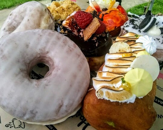 An assortment of doughnuts from Hoity Toity donuts.