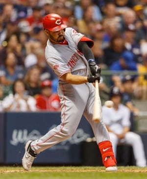 Jul 22, 2019; Milwaukee, WI, USA; Cincinnati Reds third baseman Eugenio Suarez (7) hits a two run home run during the seventh inning against the Milwaukee Brewers at Miller Park.
