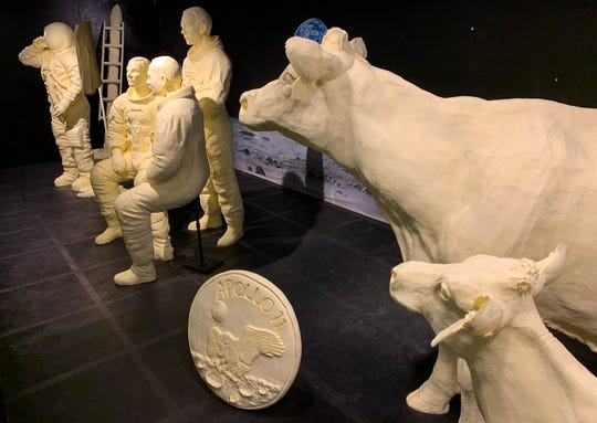 The annual butter display honors the 50th anniversary of the first moon landing and includes sculptures of Neil Armstrong saluting the American flag next to the lunar module, the full Apollo 11 crew, the official Apollo 11 patch and the traditional butter cow and calf.