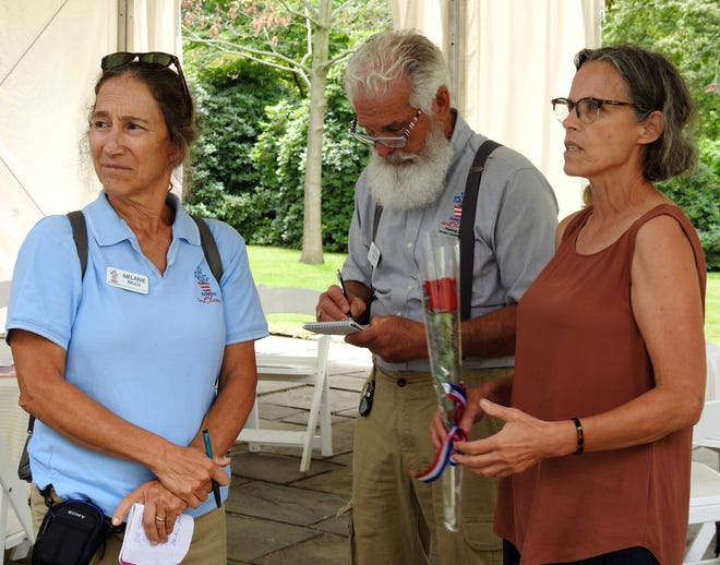 Judges Melanie Riggs and Douglas Airhart discuss the Pomerene Center for the Arts building and grounds with director Anne Cornell. Judges also stopped at the artPARK overseen by the Pomerene Center. AIB is a national floral and landscape competition. Coshocton has been involved in the competition eight times.