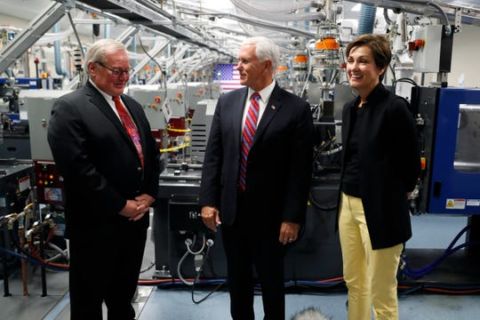 Vice President Mike Pence tours the Accumold Corp. plant with CEO Roger Hargens, left, and Iowa Gov. Kim Reynolds, right, Tuesday, July 23, 2019, in Ankeny, Iowa. (