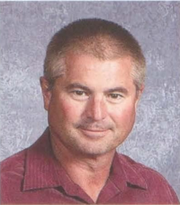Mark L. Anderson shown in a headshot for the 2013 school year at North Scott Senior High School. Anderson, 60, last taught at the school before retiring from full-time teaching in 2014. He and another teacher, Kenneth Anderson Jr., died in a Davenport swimming pool Monday, July 23, 2019.