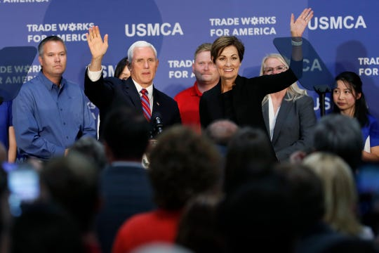 Vice President Mike Pence and Iowa Gov. Kim Reynolds wave to employees during a visit to the Accumold Corp. plant, Tuesday, July 23, 2019, in Ankeny, Iowa.