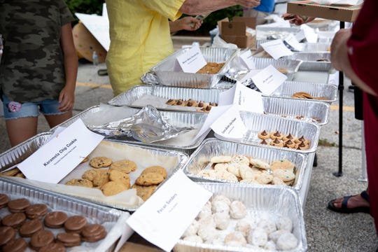 Cookie caucus hosted by Main Street School has cookies baked for each presidential candidate for riders to choose from as RAGBRAI makes its way through Norwalk on Tuesday, July 23, 2019.