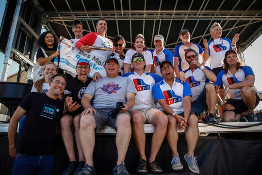 Members of the Des Moines Register and National Public Radio teams pose for a photo after the Register won the fourth annual Rhubarb Rumble pie eating contest in Winterset during RAGBRAI on Monday, July 22, 2019.