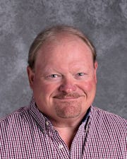 Ken O. Anderson Jr., shown in his Bellevue Community School District headshot for the 2018-19 school year. Anderson, 57, died in a Davenport pool, police say.