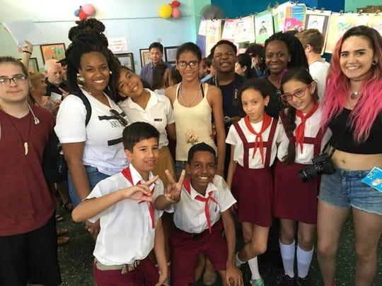 Rachel Fernandez, Jocelyn Duffie, Conrad Rodriguez, Jalyn Baity, Conrad Rodriguez, Jocelyn Duffie, Faith Duffie with school children in Havana, Cuba in March, 2016.