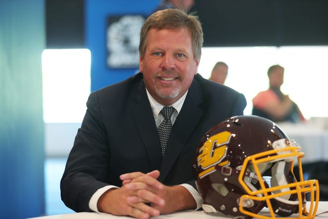 Central Michigan coach Jim McElwain talks with reporters during MAC media day at Ford Field on Tuesday, July 23, 2019.