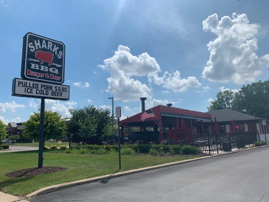 The owners of Sharks BBQ Burgers and Beer striped tracings of the pizza chain. Captured on July 17 at Rochester Road.