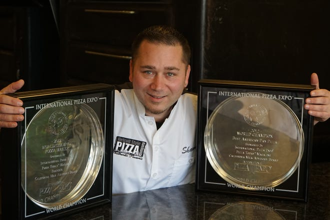 Shawn Randazzo of Detroit Style Pizza Company with his World Pizza Maker champion trophies.