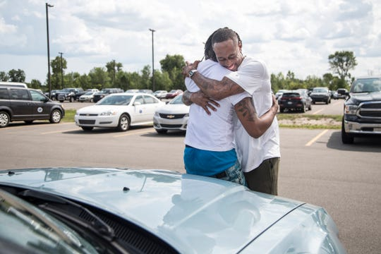 Following a Free Press investigation published in July, James Chad-Lewis Clay was exonerated after being wrongfully convicted of rape. Here he hugs his brother, following his release from the Macomb Correctional Facility in Lenox.