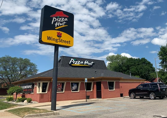 Still true the trapezoid windows and top-hat roof, this Pizza Hut remains off of South Telegraph Road. Captured July 9.