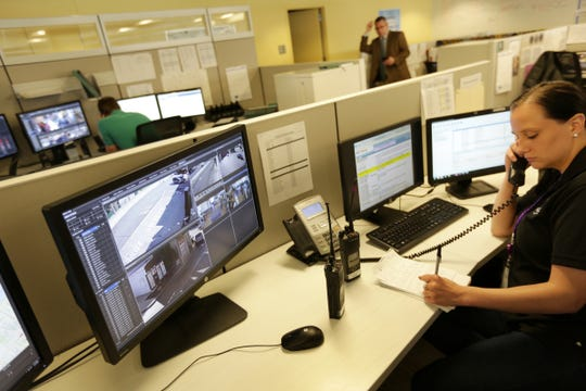 Crime analyst Breanna Lingo, right monitors video screens in the real time crime center at the Detroit Public Safety Headquarters in Detroit, MI on Monday, May 23, 2016.Romain Blanquart/Detroit Free Press