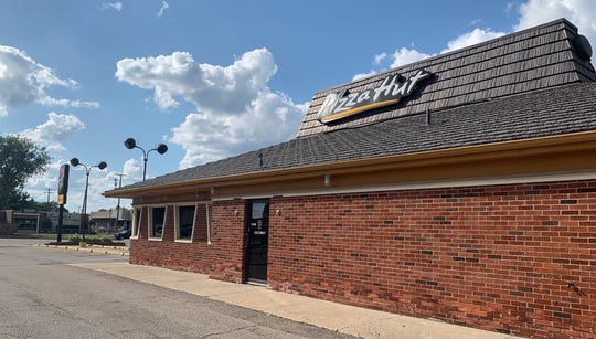 This Pizza Hut location on Dix Toledo Road remains part of the chain. Captured on July 11.