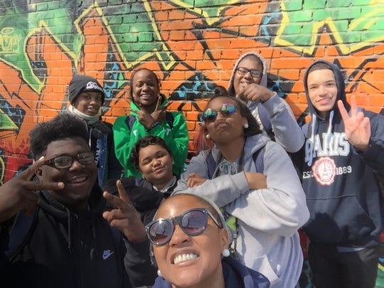 Edward Shivers, Faith Duffie, Jocelyn Duffie, Taelor Carter, Omari Gordon, Lindsey Moore, Donovan Jamison standing in front of street art in Beijing, China in April of 2016.