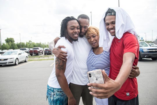 James Chad-Lewis Clay, center left, with his brother Jeremy Lyons, left, mother Ethel Marie Lyons, and god brother Dimitri Parker, FaceTime their family and friends after Clay was released from the Macomb Correctional Facility in Lenox, Tuesday, July 23, 2019.