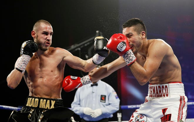 Maxim Dadashev, left, died after suffering a brain injury in a fight in Maryland. He was 28.