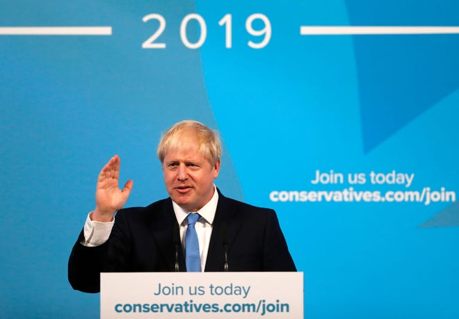 Boris Johnson speaks after being announced as the new leader of the Conservative Party in London, Tuesday, July 23, 2019.