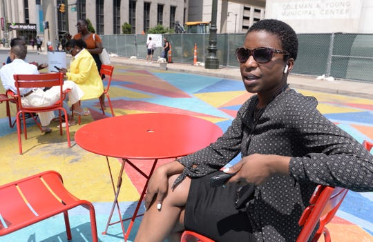 Lisa Session of Detroit takes a break from her job to enjoy Spirit Plaza this afternoon.