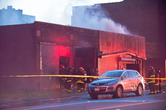 Detroit firefighters battle a blaze at the site of the former Gold Dollar bar on Monday.