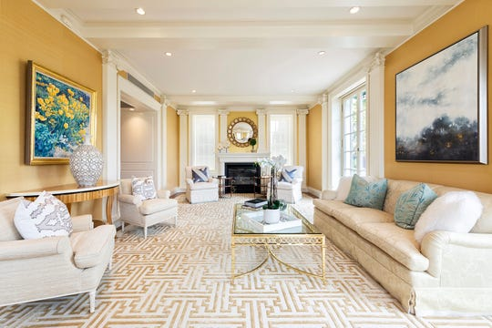 A disjointed furniture arrangement is made cohesive and unified through proper furniture placement and the addition of artwork and accessories. (Design Recipes/TNS)