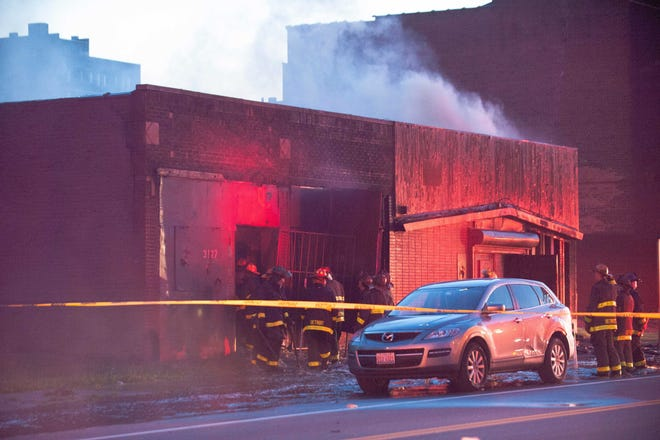 Detroit firefighters battle a blaze at the site of the former Gold Dollar bar on Cass Avenue on Monday.