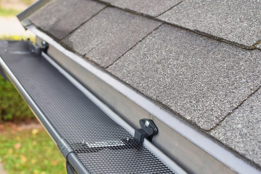 Gutter guards can extend the time between gutter cleanings, but don't think of them as a replacement for properly cleaned gutters. (Dreamstime/TNS)