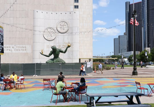 A few people enjoy Spirit Plaza in downtown Detroit on Tuesday, July 23, 2019.