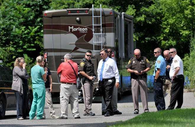 State, county and local officials investigate a complaint at Great Lakes Cremation in Lyon Twp., Tuesday.