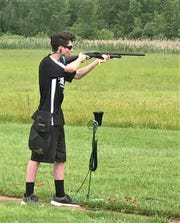 Elmira High School trap shooting team member Matt Sherwood prepares to fire at a clay target at the Sullivan Trail Rod & Gun Club.