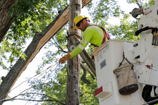 WPS works to restore power on the 800 block of 13th Avenue Tuesday, July 23, 2019, in Green Bay, Wis.