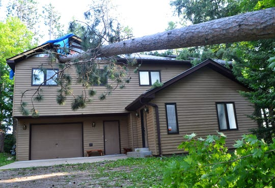 Two trees landed on this home on Oralea Lane in the town of Townsend during the July 19 storm.