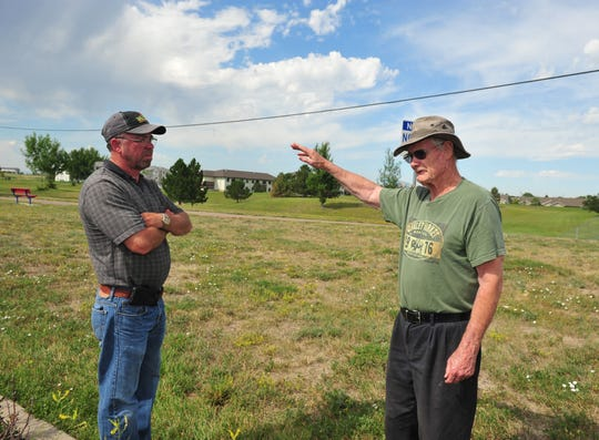 "Lonnie Dalke, parks manager for the city of Great Falls Parks and Recreation, talks with resident Roland Croghan about the overpopulation of Richardson's ground squirrels at Sandhill Park on Tuesday. ""This has been a real bad year,"" Croghan said."