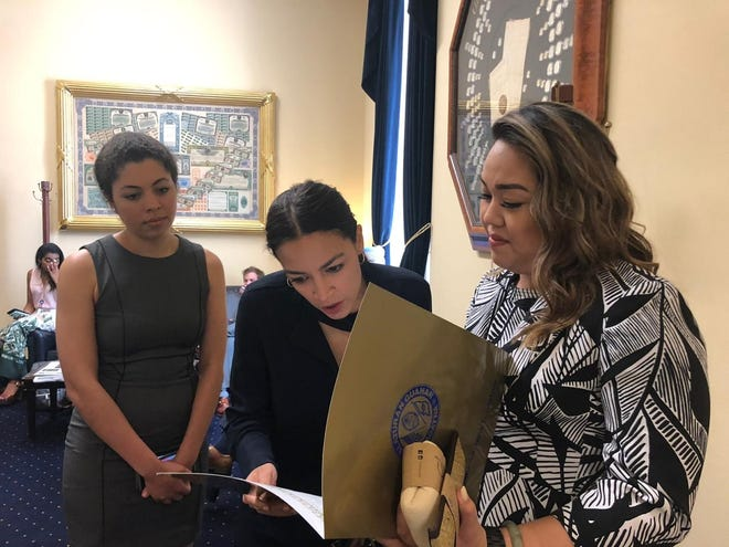 Sen. Amanda Shelton, right, with New York Rep. Alexandria Ocasio-Cortez, discussing Shelton's resolution in support of Guam Del. Mike San Nicolas' bill seeking to fix the delay in paying Guam's war reparations. San Nicolas' H.R. 1365 is up for a full House vote on July 24.