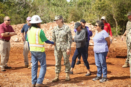 In this July 18 file photo, Gov. Lou Leon Guerrero and others visit Northwest Field. Senators have been invited to visit the live-fire training range complex next month.