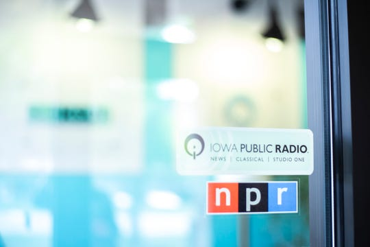 A sign for Iowa Public Radio is pictured above an National Public Radio (NPR) logo, Tuesday, July 23, 2019, at the Iowa Public Radio studios in Iowa City, Iowa.