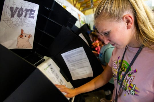 Claire Ladage, 14, of Solon, votes during a mock election at the 90th annual Johnson County Fair, Tuesday, July 23, 2019, at the Johnson County Fairgrounds in Iowa City, Iowa. Ladage won't be 18 by the time the current presidential election rolls around, but voted for Peppa Pig in the county auditor's mock election.