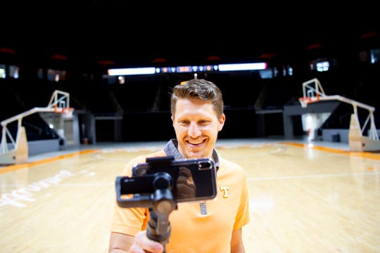 Kellen Hiser, Associate Director of Social Media Strategy at Tennessee Athletics, records an Instagram story with his handheld phone stabilizer in Thompson-Boling Arena in Knoxville, Tennessee on Tuesday, July 23, 2019. Hiser is the genius behind UT basketball's Instagram and Twitter among other social media platforms.