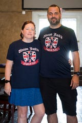 Jenn and Aaron Nelson, who own Union Jacks together, pose for a photo in their new venture, Union Place pub, Thursday, July 18, 2019.
