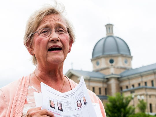 Susan Vance of the Survivors Network of Those Abused by Priests speaks in front of the Diocese of Knoxville offices on Tuesday, July 23, 2019.