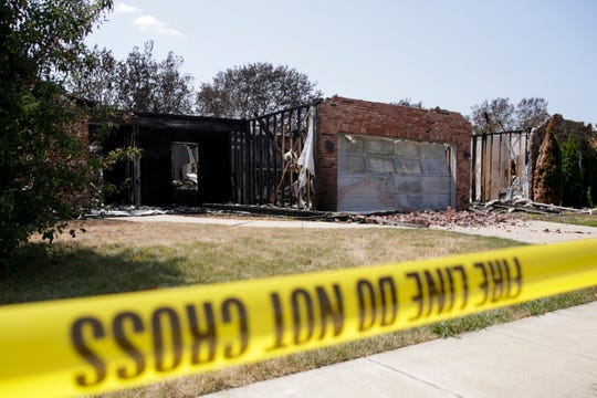Fire line tape block access to a home on the 3600 block of Tesla drive after a fire destroyed five homes, Tuesday, July 23, 2019 in West Lafayette. The fire also damaged several others on Friday, July 12.