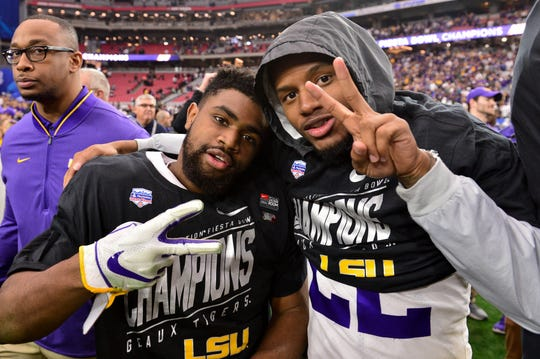 Jan 1, 2019; Glendale, AZ, USA; LSU Tigers running back Clyde Edwards-Helaire (left) and cornerback Kristian Fulton (right) celebrate after defeating the UCF Knights in the 2019 Fiesta Bowl at State Farm Stadium. Mandatory Credit: Matt Kartozian-USA TODAY Sports