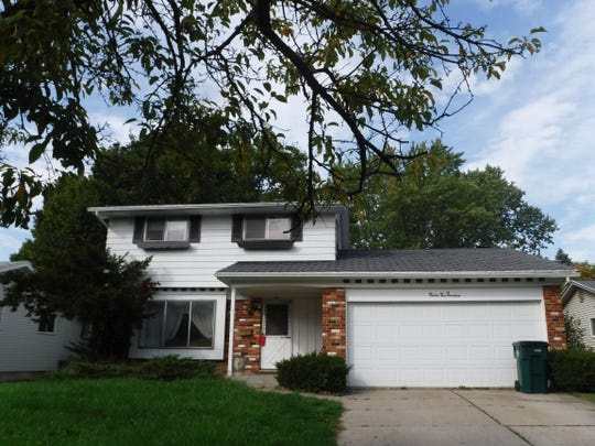 A two-story, 1,457-square-foot home on Raynell Street in Lansing is among the properties headed for auction in Ingham County on July 30.