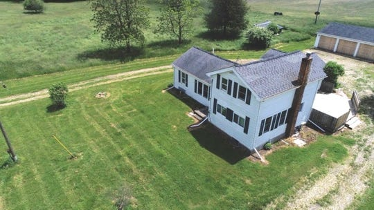 A farmhouse on Steele Highway outside Eaton Rapids that will be auctioned off this fall by Eaton County.